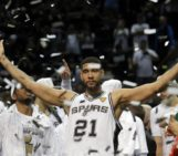 Duncan exercises option with Spurs