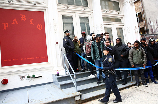 "NEW YORK, NY - MARCH 18:  NYPD guard the area near 83 Wooster Street in Soho at the Kanye West ""Pablo Pop-Up Shop"" In Manhattan on March 18, 2016 in New York City.  (Photo by Astrid Stawiarz/Getty Images)"